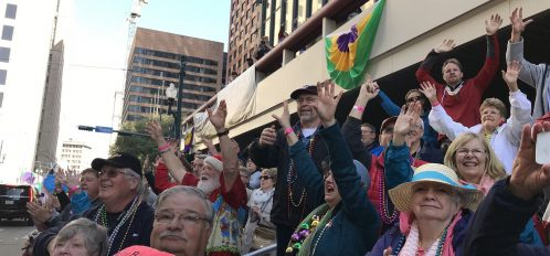 People cheer at mardi gras